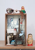 Small display case of souvenirs and Russian doll (Matryoshka) on table