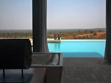 View of pool and Indian landscape from roofed terrace
