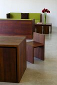 Designer table and chairs and wooden sofa frames in matching dark wood