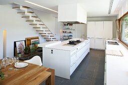 Purist designer kitchen in white with black slate floor