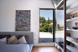 Modern living room with access to sunny terrace