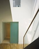 Sunny stairwell and glass partition in front of hall