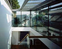 Contemporary stairwell with open glass roof