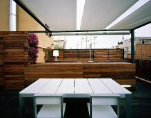 Modern terrace with kitchen, dining table and chairs