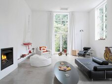 30s and 60s-style retro furniture and collection of unusual toys in high-ceilinged room