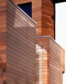 Horizontal cladding on cubic structures of modern house