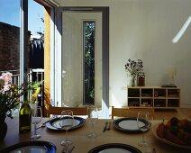 Set table in front of balcony door in plain room