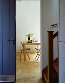 Front door and open doorway with view of dining table