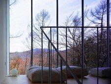 Floor cushions in front of window