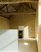 View of rustic roof timbers in renovated and modernised farmhouse