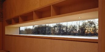 Wooden fitted cupboard with narrow integrated window