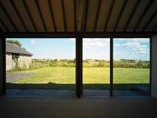 Empty living space with floor-to-ceiling terrace windows and a view