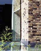 Brick house with glass extension