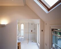 View into white bathroom with shower