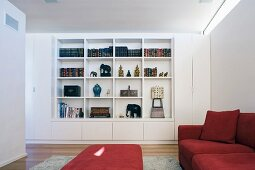 Living room with red sofa set and fitted bookcase
