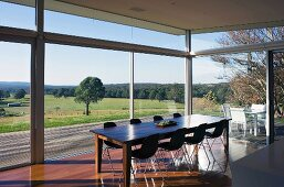 Dining room with glass wall leading to terrace