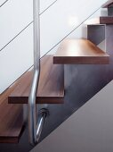 Wooden treads on stainless steel stringer and wire cable balustrade