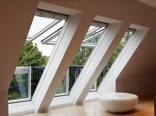 Converted attic with ceiling-height windows in slope of roof