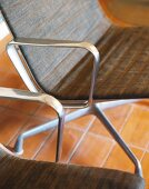 Two metal-framed chairs (detail)