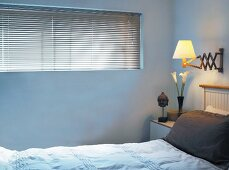 Bedroom with blinds on window