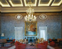 Antique European furniture contrasting with traditional, North African wall mosaics in spacious foyer