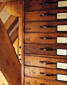 Antique set of drawers next to roof timbers