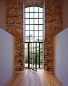 Hallway in converted house with open balcony door