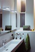 Designer washstand with illuminated, mirrored cabinet