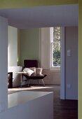 Anteroom with wide doorway and view of armchair in corner of room