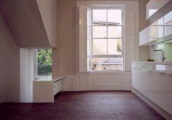 Open-plan, minimalist designer kitchen in classic setting