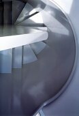 View of spiral staircase with curved stairwell wall