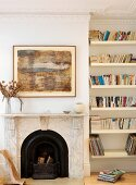 Open fireplace with marble surround and bookcase in niche