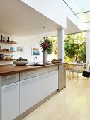 Kitchen island in open-plan kitchen of contemporary house