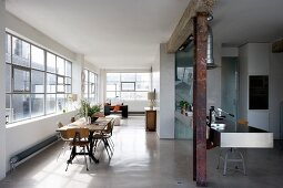 Vintage-style dining area and designer kitchen in loft apartment