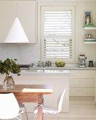 Rustic dining area in white, designer kitchen