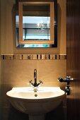 View of sink and mirror through open door