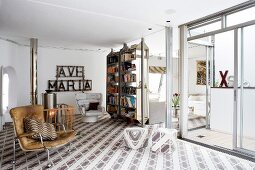 Kooky, sunny living room in youthful vintage style with eye-catching patterned flooring