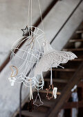Paper-wrapped biscuit cutters hanging from lampshade