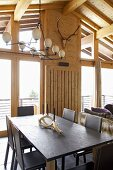 Candlestick on dining table in rustic, modern room
