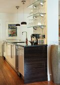 Free-standing kitchen island in front of pillar with glass shelves