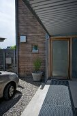 Roofed walkway and front door of contemporary house