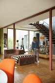 Children in open-plan room with 70s-style furniture
