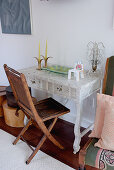 Folding wooden chair at Postmodern bureau
