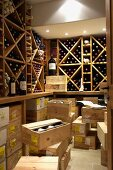 A wine rack and a stack of wooden boxes in a well-stocked wine cellar