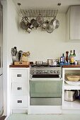 Simple, modern kitchen cabinets with a saucepan hanger on the ceiling