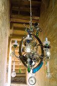 Vintage chandelier decorated with glass droplets and clock ornaments