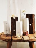 Various white vases and blocks of wood on rustic footstool