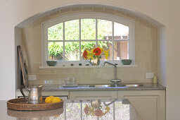 Kitchen counter in arched niche below window