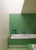 Contemporary bathroom with retro green mosaic tiles on bathtub panel and wall