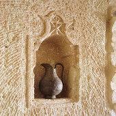 Metal jug in Oriental wall niche